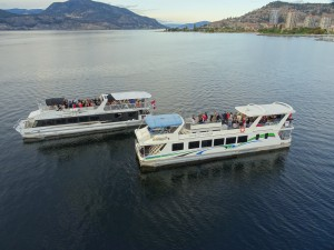 both-boats-port-side-looking-north-with-waterscapes-on-the-disctance-close-up-okanagan-lake